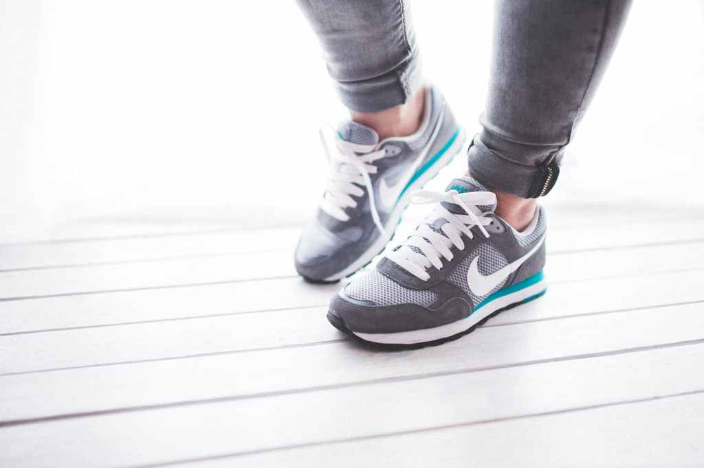 Man wearing sport shoes getting ready to walk