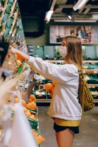 A lady picking up grocery from shelf